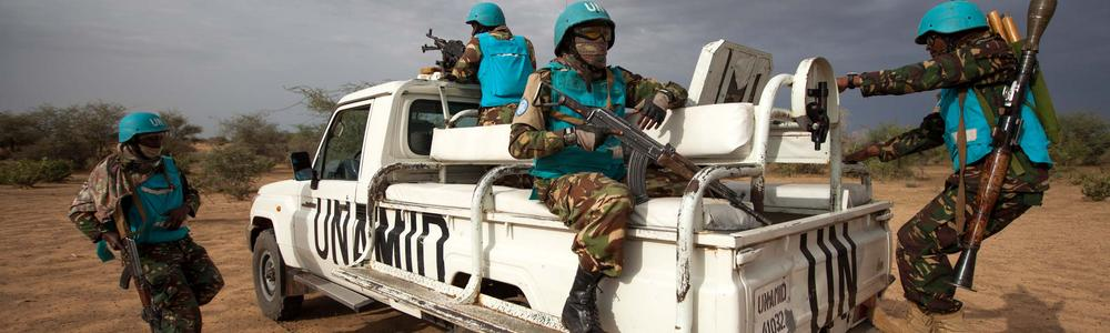 Tanzanian troops of the joint UN-African Union Mission in Darfur (UNAMID) conduct a patrol in Karbab village.