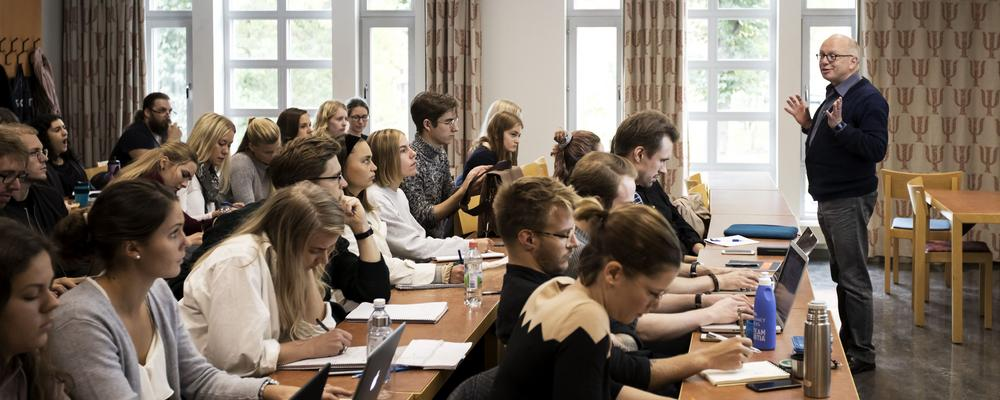 Students sits and listens during lecture