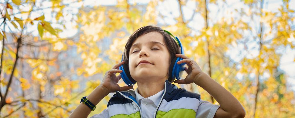 Boy in forest with headphones on