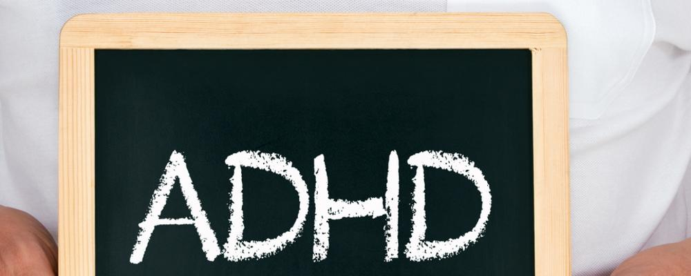 Doctor holding up board with ADHD diagnosis