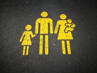 an asphalt drawing of a family of a father, mother and two children