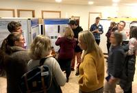 People mingle during poster session at CeMEB conference